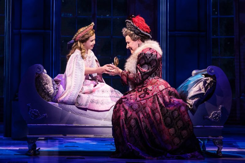 The Dowager Empress tucks her granddaughter, Young Anastasia, into bed.