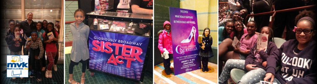 Kids pose in front of broadway posters